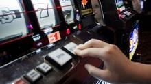 Slot machines pictured in a file photo. Ontario Lottery and Gaming Corp. is permanently shutting down slot machine operations at racetracks in three border cities. (JOHN LEHMANN/The Globe and Mail/JOHN LEHMANN/The Globe and Mail)