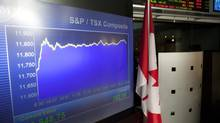 The screens at the TMX Broadcast Centre in Toronto show the closing numbers of the TSX at +252.19 on July 3, 2012. (Matthew Sherwood For The Globe and Mail)