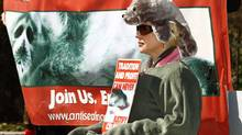 An anti-sealing protester takes part in a in Halifax rally on March 13, 2010. (PAUL DARROW)