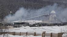Smoke rises from the Babine Forest Products mill in Burns Lake, B.C. Sunday, Jan. 22, 2012. A fireball levelled the mill, which produces products like framing lumber, just after shift-change the preceding Friday evening. (JONATHAN HAYWARD/The Canadian Press)