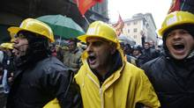 Steel workers rally outside the Italian parliament, in Rome, Nov. 29, 2012, after the ILVA plant in southern Italy at the centre of an environmental scandal announced plans to close. (Andrew Medichini/AP)