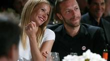 This Jan. 11, 2014 file photo shows actress Gwyneth Paltrow, left, and her husband, singer Chris Martin at the 3rd Annual Sean Penn & Friends Help Haiti Home Gala in Beverly Hills, Calif. (Colin Young-Wolff/Invision/AP)
