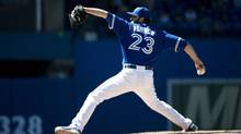 Toronto Blue Jays starting pitcher Brandon Morrow works against the Seattle Mariners during eighth inning AL baseball action in Toronto on Sunday, May 5, 2013. (Nathan Denette/THE CANADIAN PRESS)