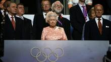 Britain's Queen Elizabeth and Prince Phillip attend the opening ceremonies of the London 2012 Olympic Games. (KAI PFAFFENBACH/REUTERS)