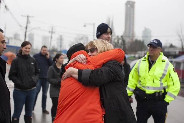 Donna May, right, runs into Tracie Jones, a registered nurse at Surrey Emergency who knew Ms. May's daughter, during a visit in the area known as