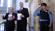 Finance Minister Jim Flaherty and Prime Minister Stephen Harper walk to the House of Commons to deliver the federal budget on Parliament Hill on March 21, 2013. (BLAIR GABLE/REUTERS)