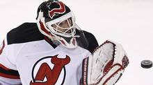 New Jersey Devils' goalie Martin Brodeur watches the puck during the second period of their NHL hockey game against the Ottawa Senators in Ottawa January 2, 2012 REUTERS/Chris Wattie (CHRIS WATTIE)