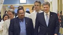 Prime Minister Stephen Harper chats with Dr. Arthur Porter at a Montreal hospital on Nov.24, 2006. (Ryan Remiorz/Ryan Remiorz/The Canadian Press)