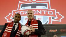Toronto FC new soccer players Jermain Defoe (left) and Michael Bradley attend a news conference in Toronto, Jan.13, 2014. (Frank Gunn/THE CANADIAN PRESS)