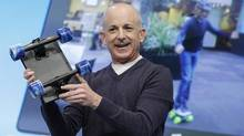 Former Windows chief Steven Sinofsky holds a Surface tablet with skateboard wheels attached to show the strength of the device during the launch event for Microsoft Windows 8 in New York, in this Oct. 25, 2012 file photo. (LUCAS JACKSON/REUTERS)