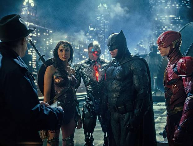J.K. Simmons as Commissioner Gordon, Gal Gadot as Wonder Woman, Ray Fisher as Cyborg, Ben Affleck as Batman and Ezra Miller as the Flash in Justice League.