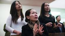 Alma Galve is emotional as she sings during a church service at Toronto's Filipino Alliance Church on Nov. 10, 2013, days after Typhoon Haiyan hit the Philippines. (MICHELLE SIU FOR THE GLOBE AND MAIL)