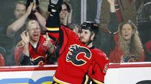 Calgary Flames' Curtis Glencross celebrates his goal during third period NHL action against the Detroit Red Wings in Calgary, Alta., Wednesday, March 13, 2013. The Calgary Flames beat the Detroit Red Wings 5-2. (Jeff McIntosh/THE CANADIAN PRESS)