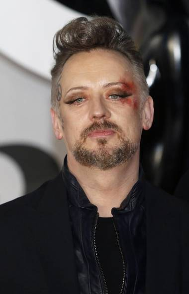 Don't ask us to explain but most of the major star happenings were in the U.K. this past week. Here's eighties pop star Boy George at the Brit Awards in London sporting a nifty hairpiece, Sharpie face-tattoo and what appears to be a nasty contusion from falling off the bus on the way there. Still a karma chameleon after all these years! (LUKE MACGREGOR/REUTERS)