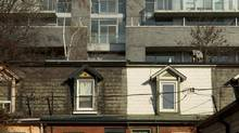 The design of these older Corktown homes contrasts sharply with the architecture of a new building on King Street east. This is part of a collection of images from the Corktown area of Toronto taken on Dec. 12, 2012. (Peter Power/The Globe and Mail)
