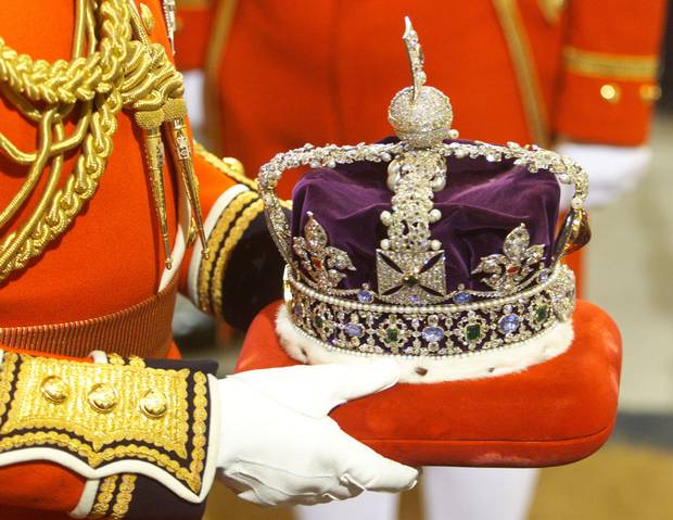 The Imperial State Crown is carried into Britain's Parliament.