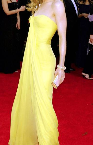 Yellow can be a tricky shade to pull off even for the beautiful people, making Renée Zellweger's ethereal vintage lemon-chiffon Jean Desses number an even bigger fashion win. She wore it to the 2001 ceremony with perfect partners - maximum bling and beachy hair - and had us at hello. (LAURA RAUCH/AP)