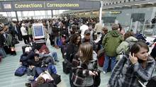 Passengers sleep on the floor as they wait in line to board U.S. bound flights at Toronto's Pearson International airport in this Dec. 27, 2009 file photo. (J.P. MOCZULSKI/J.P. Moczulski/The Globe and Mail)
