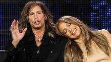 Steven Tyler and Jennifer Lopez take part in Pasadena on Tuesday. (Reuters)