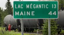Montreal, Maine & Atlantic Railway had only $25-million in third-party liability insurance before the derailment and explosion in Lac-Mégantic, Que., in July, 2013. (PETER POWER/THE GLOBE AND MAIL)