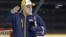Barry Trotz, the former coach of the Nashville Predators, is the leader in the NHL's annual coaching sweepstakes. (Mark Humphrey/AP)
