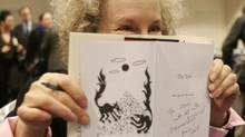 Author Margaret Atwood, seen here in London, England in 2006, signs books for fans in New York using the Long-pen device. (Randy Quan/The Globe and Mail)