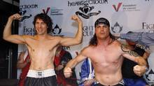 Conservative Senator Patrick Brazeau, right, and Liberal MP Justin Trudeau take part in a weigh-in for a upcoming boxing match Wednesday March 28, 2012, in Ottawa. The pair will meet this Saturday night where they will to go three rounds in a charity boxing match for cancer research. (Fred Chartrand/The Canadian Press/Fred Chartrand/The Canadian Press)