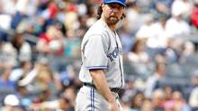 Toronto Blue Jays starting pitcher R.A. Dickey looks towards the New York Yankees dugout after Yankees Lyle Overbay hit a go ahead two-run home run during the seventh inning of their American League baseball game at Yankee Stadium in New York, April 28, 2013. (ADAM HUNGER/REUTERS)