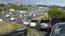 Rush hour traffic from Highway 400 merges with the eastbound Highway 401 during rush hour in Toronto (2009 file photo). (Randall Moore/The Globe and Mail)