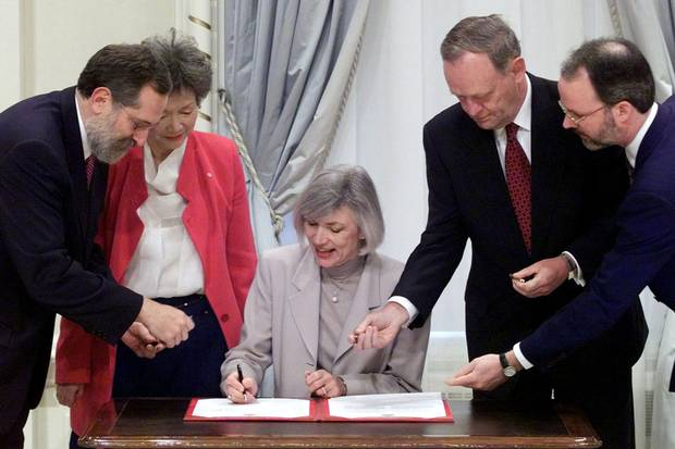 Jan. 12, 2000: Beverley McLachlin, newly sworn in as chief justice, is offered pens by Mel Cappe, left, president of the Privy Council; prime minister Jean Chrétien and the Governor-General's aide-de-camp, Jocelyn Turgeon, far right, as Governor-General Adrienne Clarkson looks on.