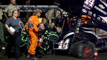 In this Aug. 5, 2013 photo, NASCAR driver Tony Stewart is loaded into an ambulance after being involved in a four-car wreck at Southern Iowa Speedway in Oskaloosa, Iowa. (Mary Willie/AP Photo)
