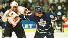 Gino Odjick of the Vancouver Canucks and Tie Domi of the Toronto Maple Leafs fight during a 1995 NHL game (Jeff Vinnick/Reuters)