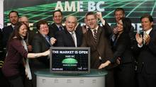 Bill Bennett, B.C. Minister of Energy and Mines and Minister responsible for Core Review, middle, helps open the Toronto Stock Exchange. (Mark Blinch)