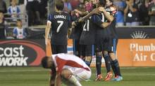 Toronto FC midfielder Darel Russell (16) reacts as Philadelphia Union midfielder Jose Kleberson (19), midfielder Michael Farfan (21) and midfielder Brian Carroll (7) celebrate win at PPL Park. The Union defeated Toronto FC, 1-0 in stoppage time. (Eric Hartline/USA TODAY Sports)