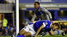 Everton's Nikica Jelavic collides with the post after scoring a disallowed goal during their English Premier League soccer match against Newcastle United at Goodison Park in Liverpool, northern England, September 17, 2012. (DARREN STAPLES/REUTERS)