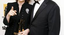 Nora Ephron with Steven Spielberg after accepting the Screenwriter Award at the 13th annual Hollywood Awards gala in Beverly Hills, California on October 26, 2009. (MARIO ANZUONI/Reuters)