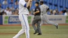 Toronto Blue Jays pitcher Aaron Laffey walks to the mound after giving up a home run to Chicago White Sox batter Dewayne Wise (R ) during the third inning of their American League baseball game in Toronto August 16, 2012. (MIKE CASSESE/REUTERS)