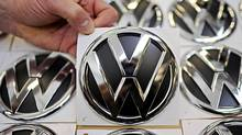 Volkswagen emblems on a production line at the German auto maker's plant in Wolfsburg in this March 7, 2012 file photo. (FABIAN BIMMER/REUTERS)