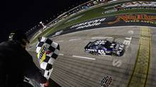 Jimmie Johnson (48) takes the chequered flag to win the NASCAR Sprint Cup Series auto race at Texas Motor Speedway on Nov. 4, 2012, in Fort Worth, Texas. (Chris Graythen/AP Photo)
