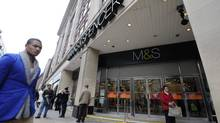 Pedestrians walk past the Marble Arch branch of Marks and Spencer in central London June 8, 2012. (PAUL HACKETT/Reuters)