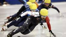 Canada's Charles Hamelin (front) competes to win the men's 500m finals during the ISU Short Track World Cup speed skating competition in Shanghai September 28, 2013. (ALY SONG/REUTERS)