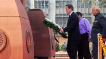 British Prime Minister David Cameron lays a wreath at the site of a notorious 1919 massacre of hundreds of Indians by British colonial forces, in Amritsar, India, Feb. 20, 2013. (AP)