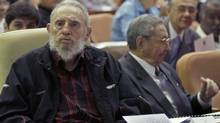 Cuba's leader Fidel Castro and his brother Cuba's President Raul Castro attend the opening session of the National Assembly in Havana, Sunday, February 24, 2013. (Ismael Francisco/AP)