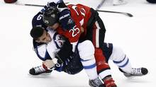 Ottawa Senator Chris Neil fights with Winnipeg Jet Evander Kane during the first period on Jan. 16, 2012. (Chris Wattie/Reuters/Chris Wattie/Reuters)