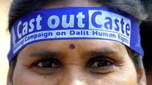 "An Indian female Dalit, member of Hinduism lowest caste, wears a headband bearing the slogan ""Cast Out Caste"" as she marches at the 2004 World Social Forum (WSF), in Bombay. (INDRANIL MUKHERJEE/AFP/Getty Images)"