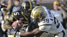 Hamilton Tiger-Cats quarterback Kevin Glenn is tackled by Winnipeg Blue Bombers linebacker Marcellus Bowman during the first half of their CFL football game in Hamilton July 1, 2011. (Reuters)