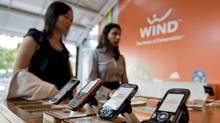 Customers shop at a Wind Mobile retail store in Toronto on Aug. 26, 2010. (1--Sarah Dea/Sarah Dea/The Globe and Mail)