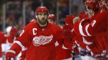 Detroit Red Wings left wing Henrik Zetterberg celebrates his goal against the Montreal Canadiens in the first period of an NHL hockey game, Friday, Jan. 24, 2014, in Detroit. (Paul Sancya/AP)