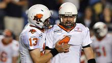 BC Lions' Paul McCallum (R) celebrates his game-winning field goal against the Winnipeg Blue Bombers with team mate Mike Reilly during the second half of their CFL game in Winnipeg, August 24, 2012. (Reuters)
