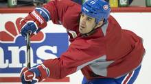 Montreal Canadiens Scott Gomez takes a shot during an informal practice Thursday, January 10, 2013 in Brossard, Que. (Paul Chiasson/THE CANADIAN PRESS)